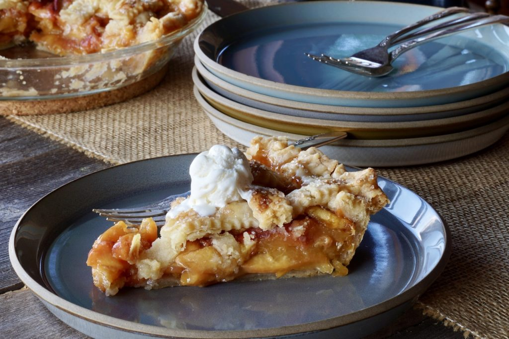 A slice of Classic Peach Pie