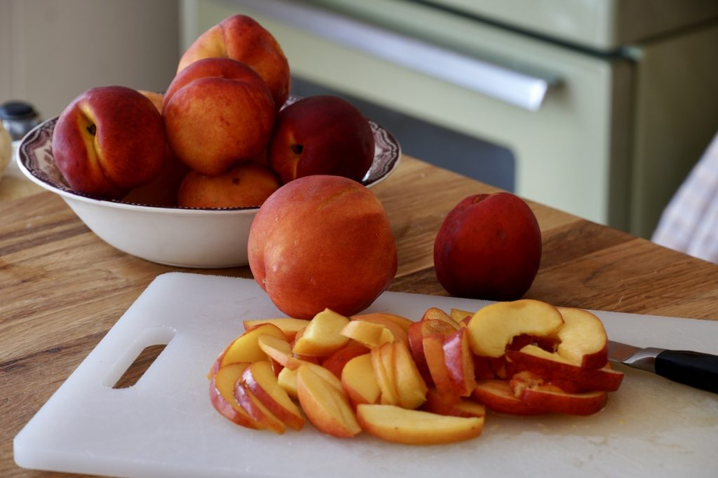 Fresh peaches sliced for the pie