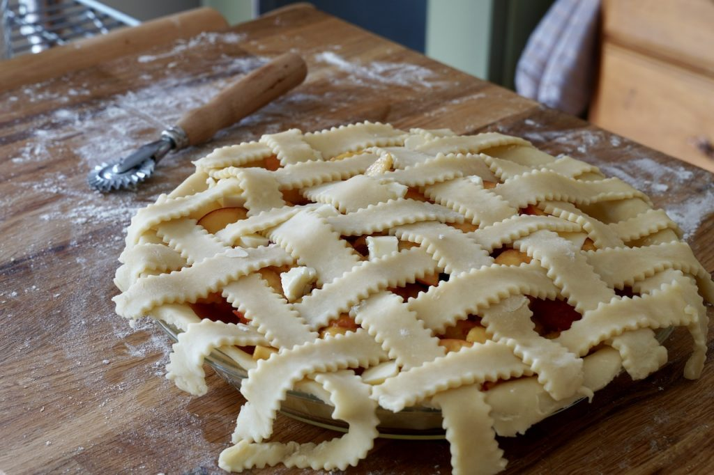 Lattice weave of pie dough on the top of the pie