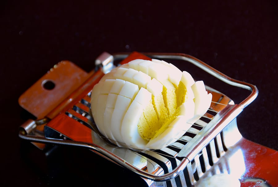 A hard-boiled egg on a slicer