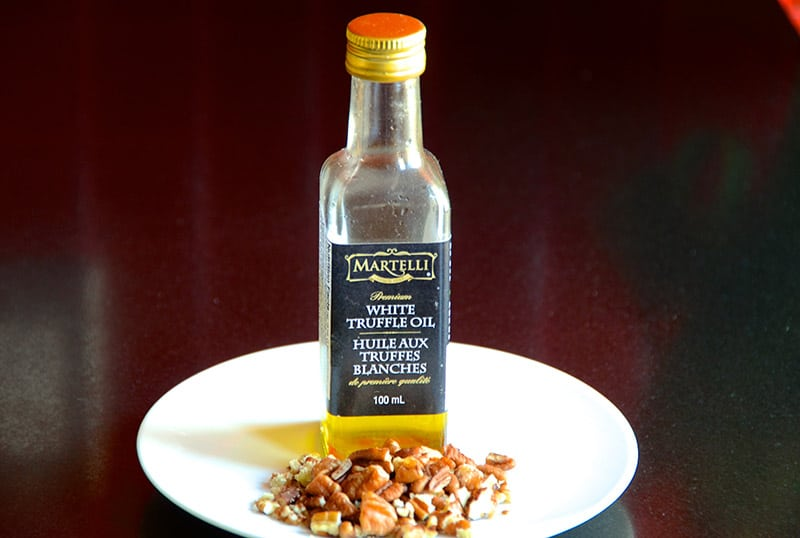Garnish with white truffle oil and chopped pecans