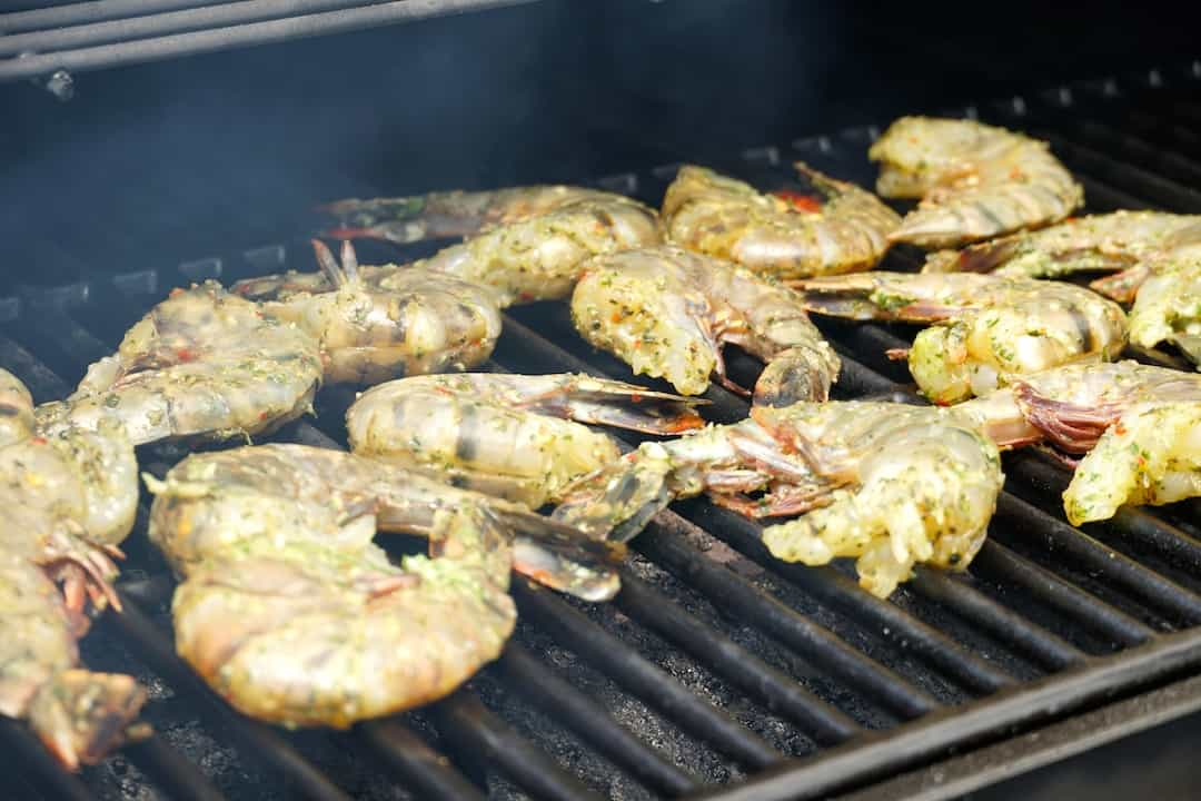 The shrimp cooking on the sizzling grill