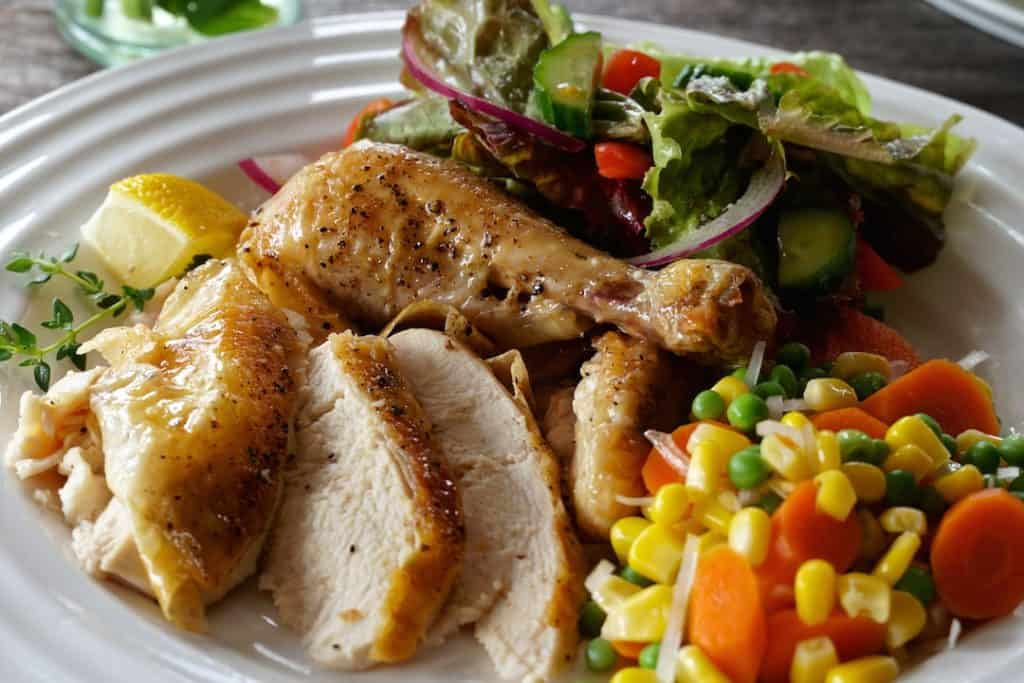 Easy Roast Chicken sliced on a dinner plate