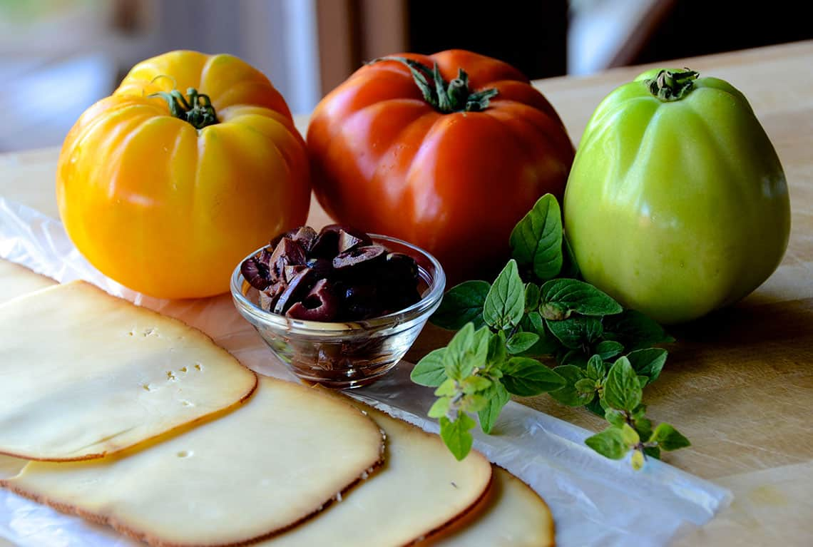 Tomatoes, Gouda, oregano and olives