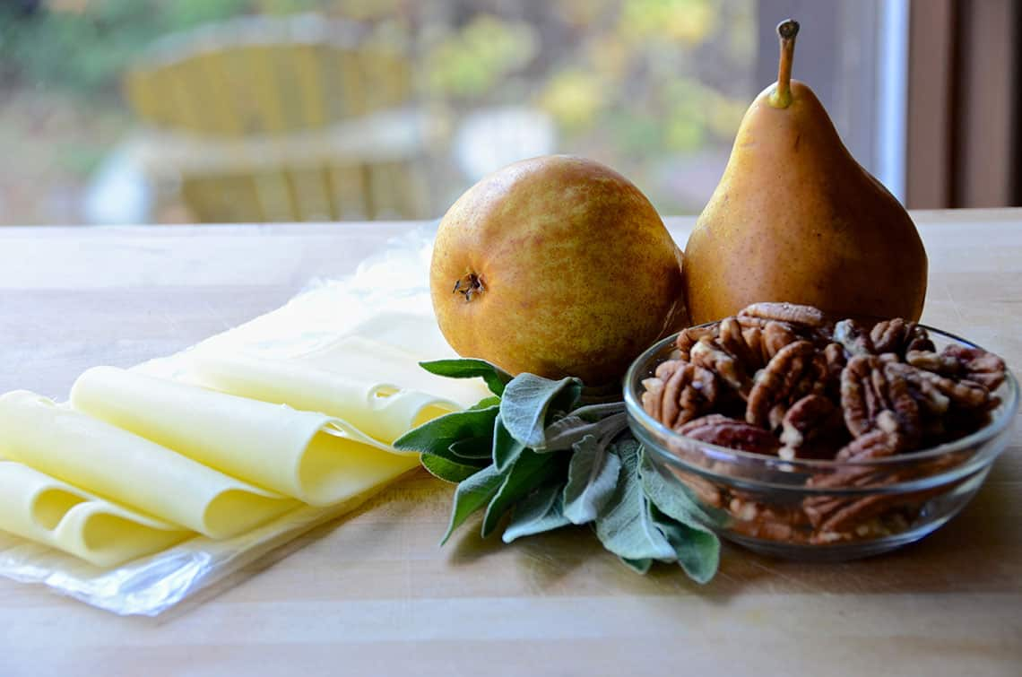 Swiss cheese with pears, pecans and sage