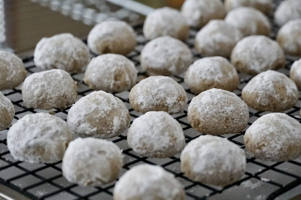 Melt-In-Your-Mouth Pecan Cookies rolled in icing sugar