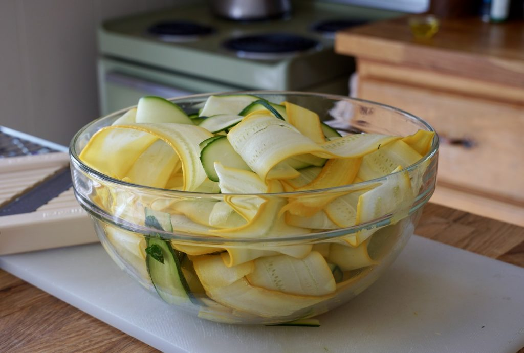 Thinly shaved yellow and green zucchini