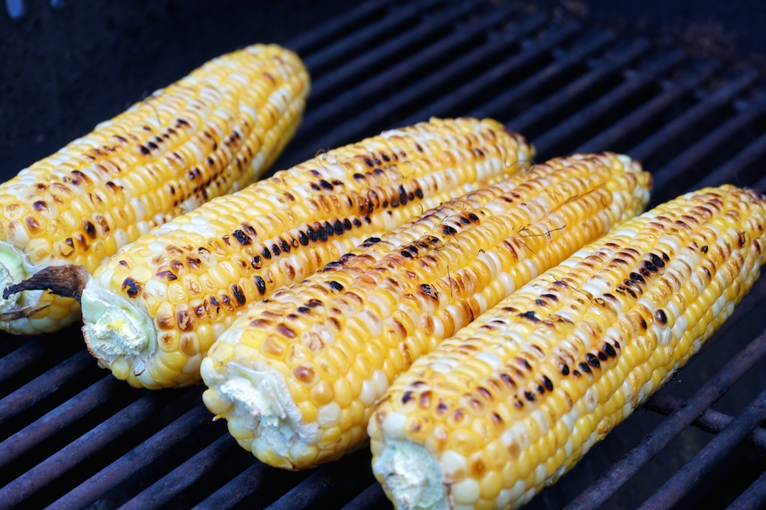 Cob of corn toasting up on the grill