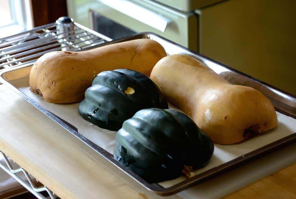 Acorn and butternut squash ready to be roasted