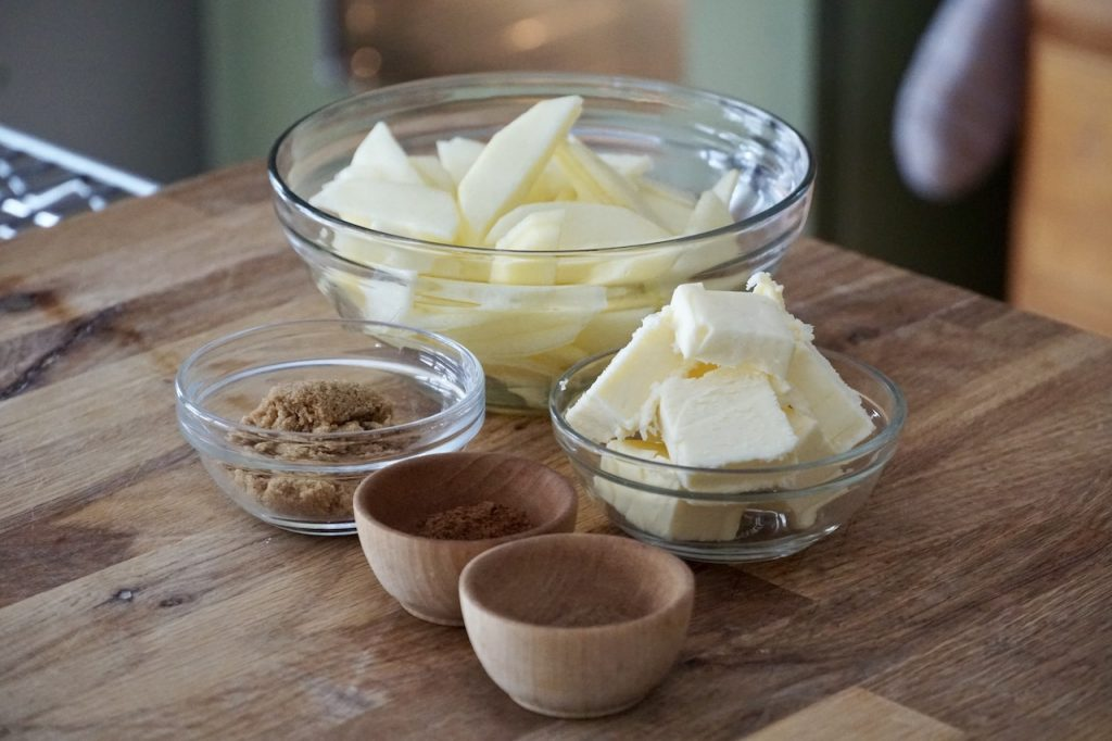 The butter, sugar and spic es to cook the apples in