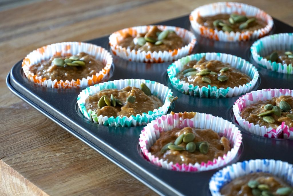 Batter portioned into the muffin tin