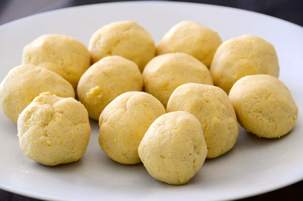 The tortilla dough rolled into balls ready to be pressed into tortillas