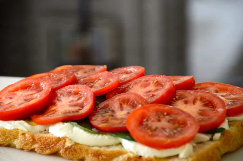 All of the ingredients layered onto focaccia bread