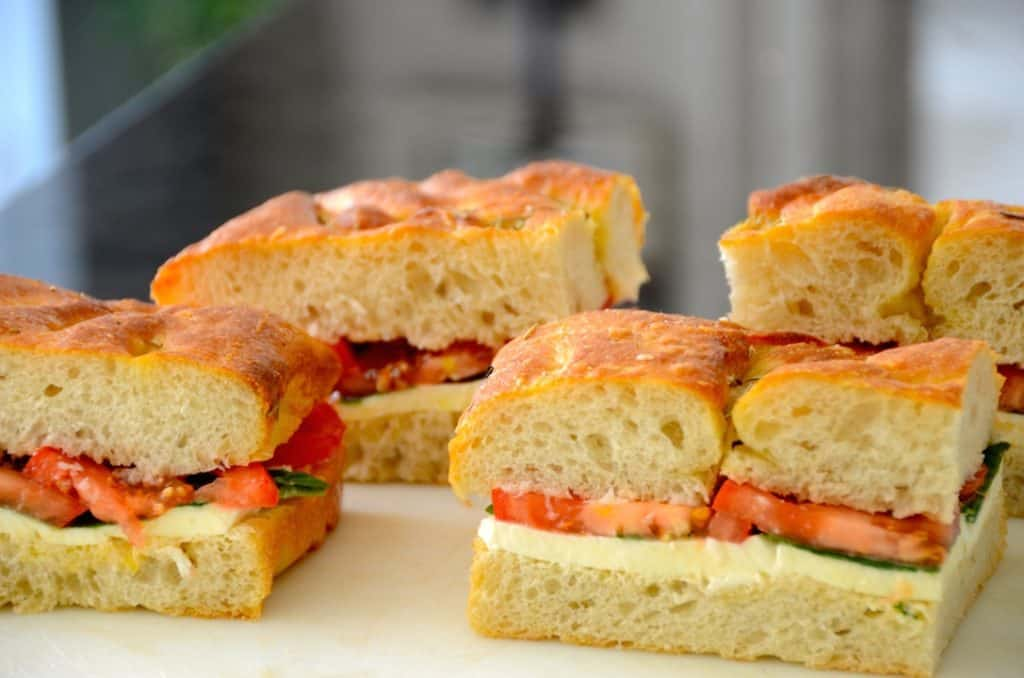 The large square of focaccia cut into smaller sandwich sizes for grilling