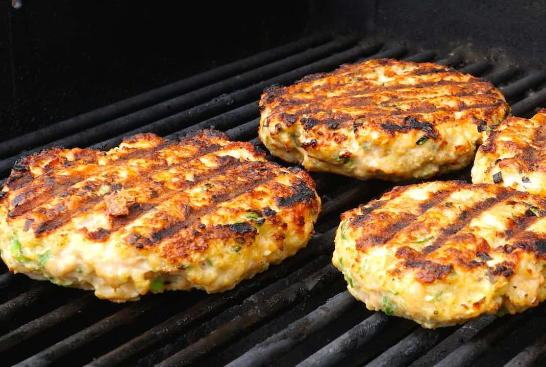 Salmon burgers cooked to perfection on the grill