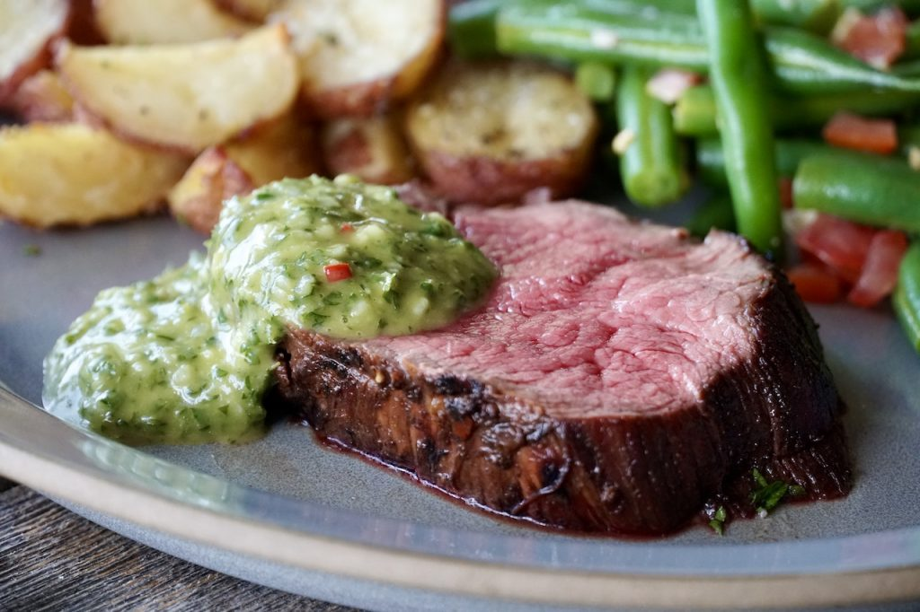 Perfectly prepared grilled beef tenderloin served with a garlic and herbed chimichurri sauce...