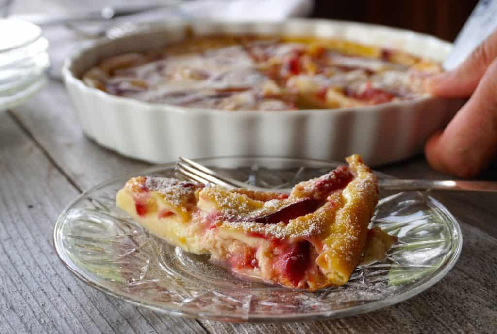 Easy Plum Clafoutis served with just a dusting of icing sugar