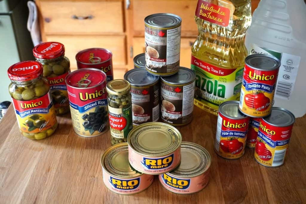 Assorted canned ingredients like olives, mushrooms and tomato sauces