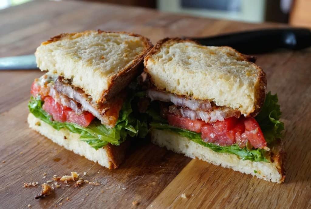 Pork Belly Sandwich cut in half