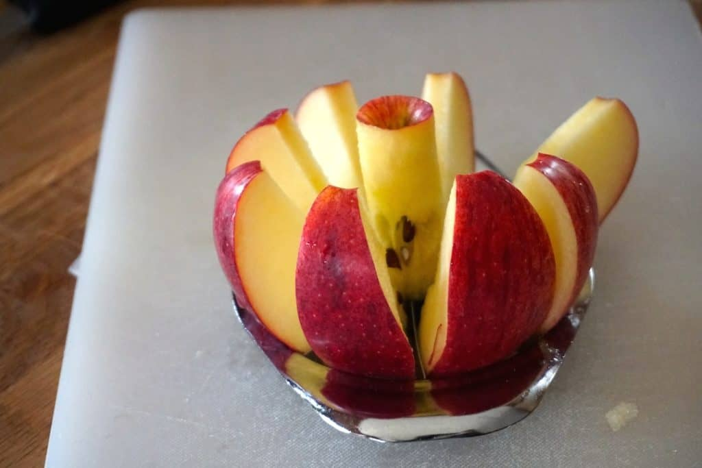 An apple cored and cut into segments