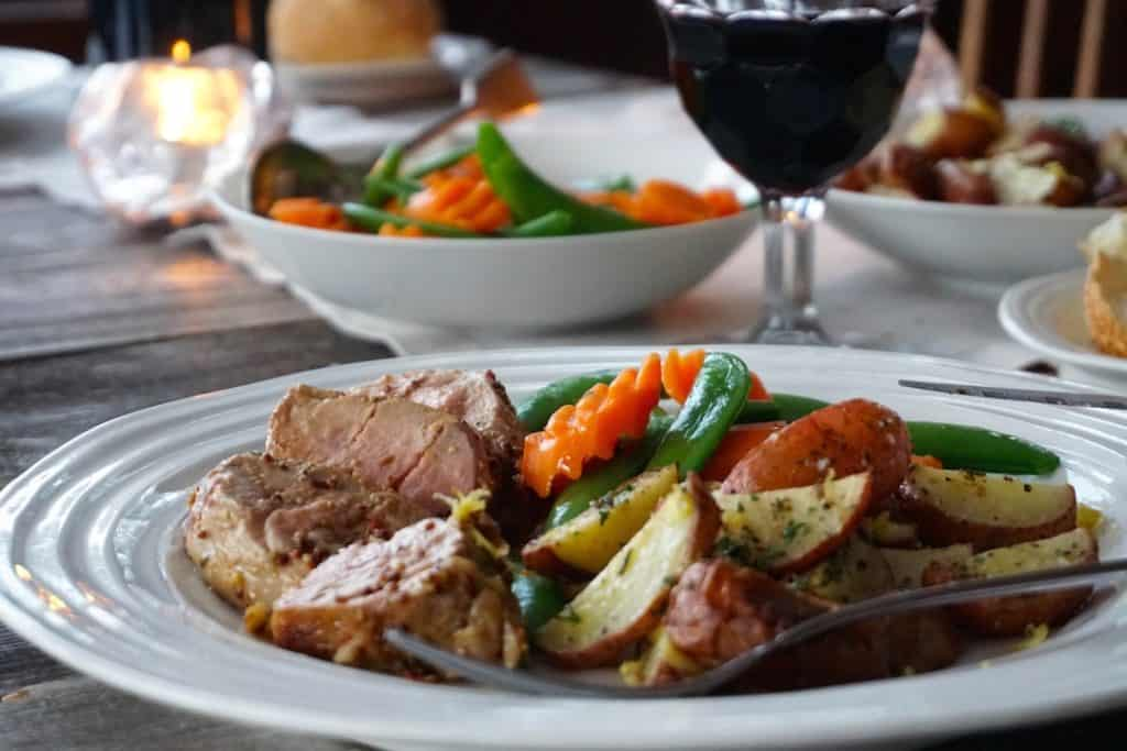 Oven-Roasted Pork Tenderloin served with vegetables and roasted potatoes