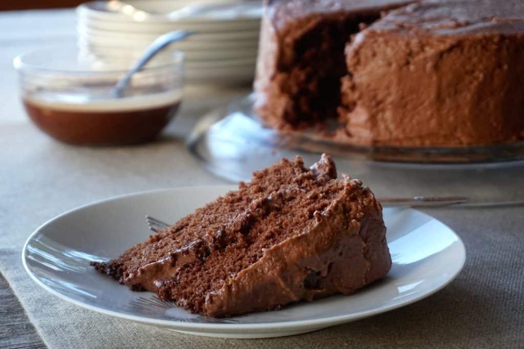 Creamy icing on a piece of Homemade Chocolate Cake