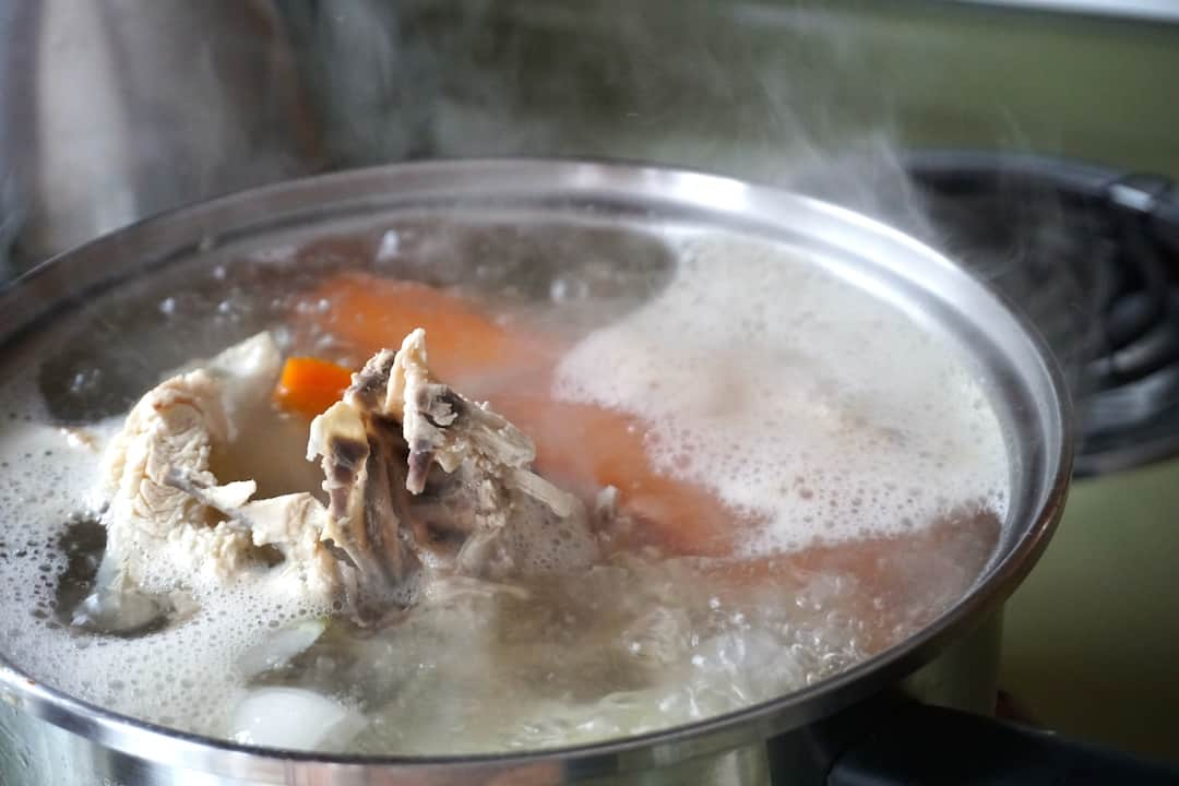 The chicken broth made using a chicken carcass