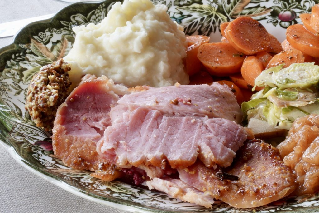 The Glazed Oven-Baked Ham served with favourite sides