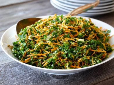 Kale, Carrot & Parmesan Salad presented in a large salad bowl