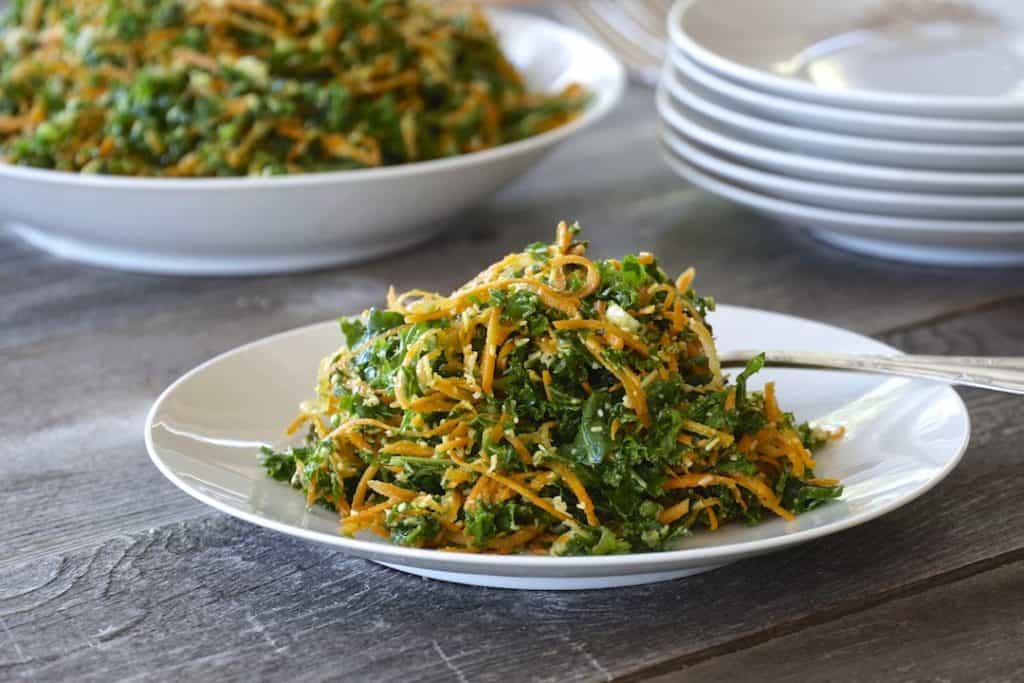 Kale, Carrot & Parmesan Salad served on a small plate