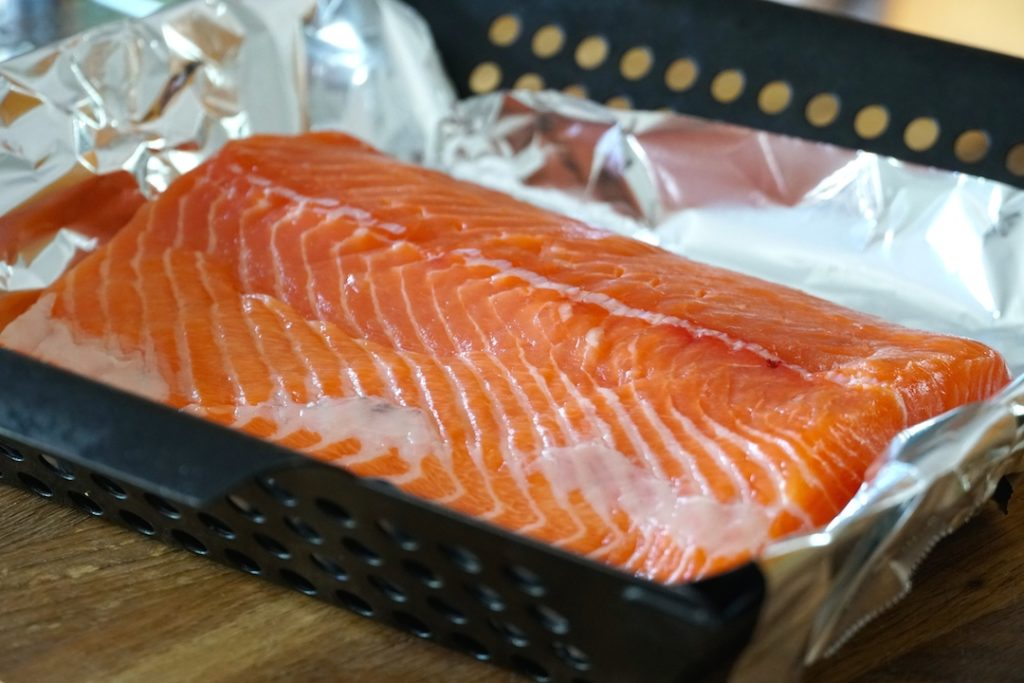Fillet of fresh salmon in a barbecue basket