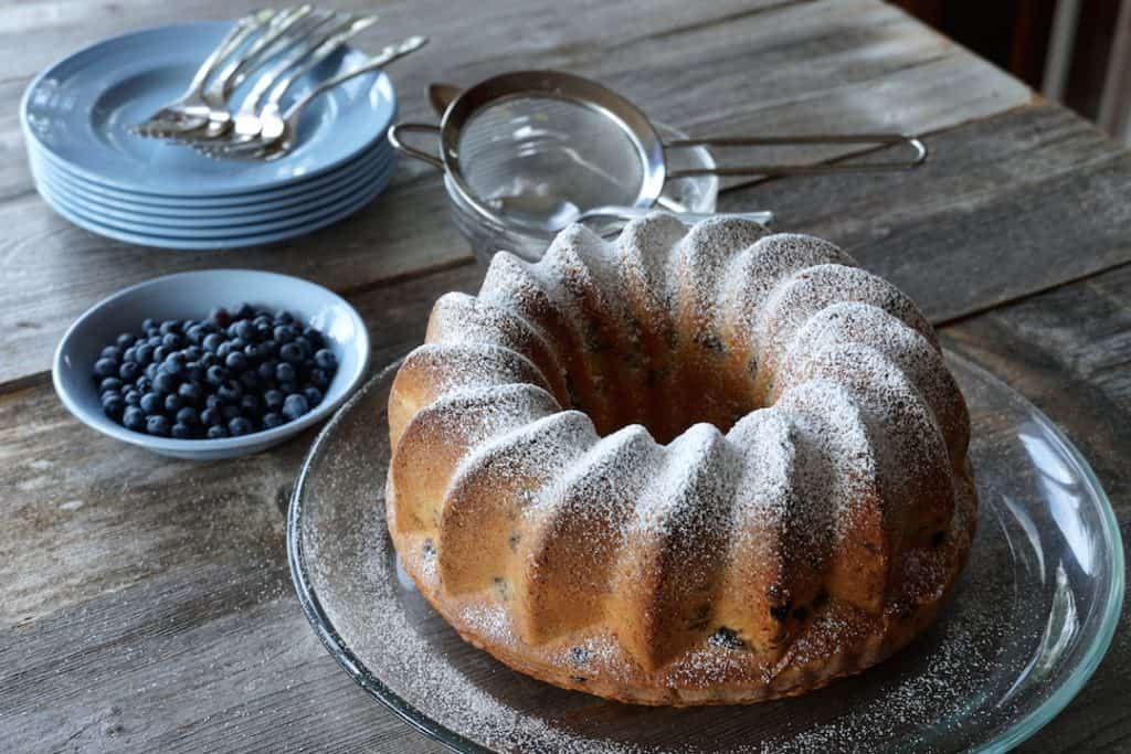 Blueberry Bundt Cake ready to be served, dusted with icing sugar