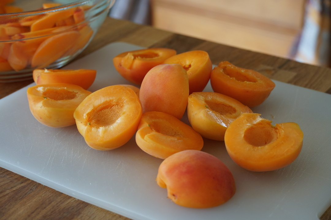 Freshly picked apricots split in half with the stones removed