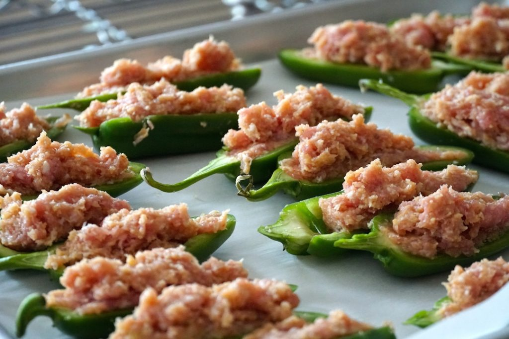 Peppers filled with sausage, cheese and breadcrumb mixture