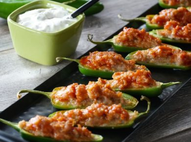 Sausage-Stuffed Jalapeños served with Lime Crema