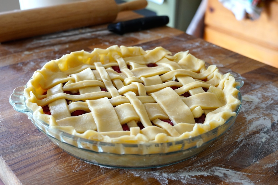 An interesting treatment for the top of the pie, a trellis design of dough