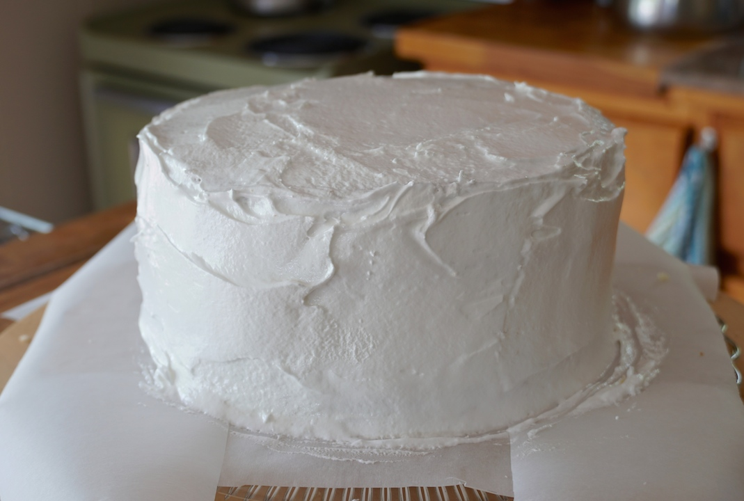 The coconut cake frosted and looking wonderfully scrumptious