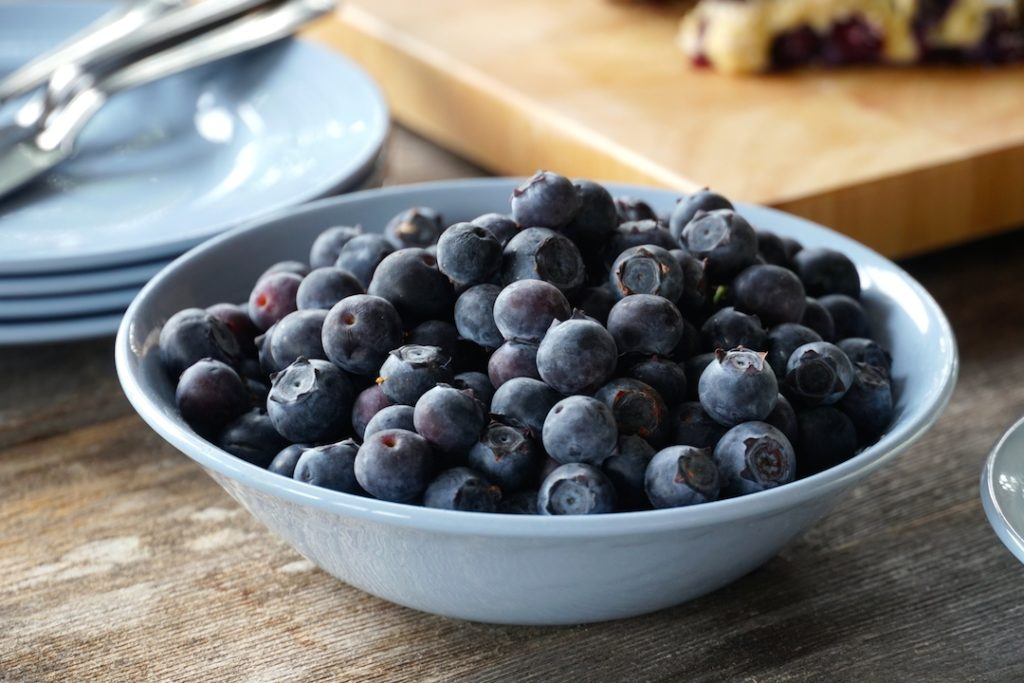 A bowl of blueberries on the side