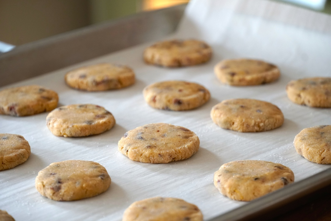 The cookies get pressed down on the baking sheets with a flat-bottomed glass