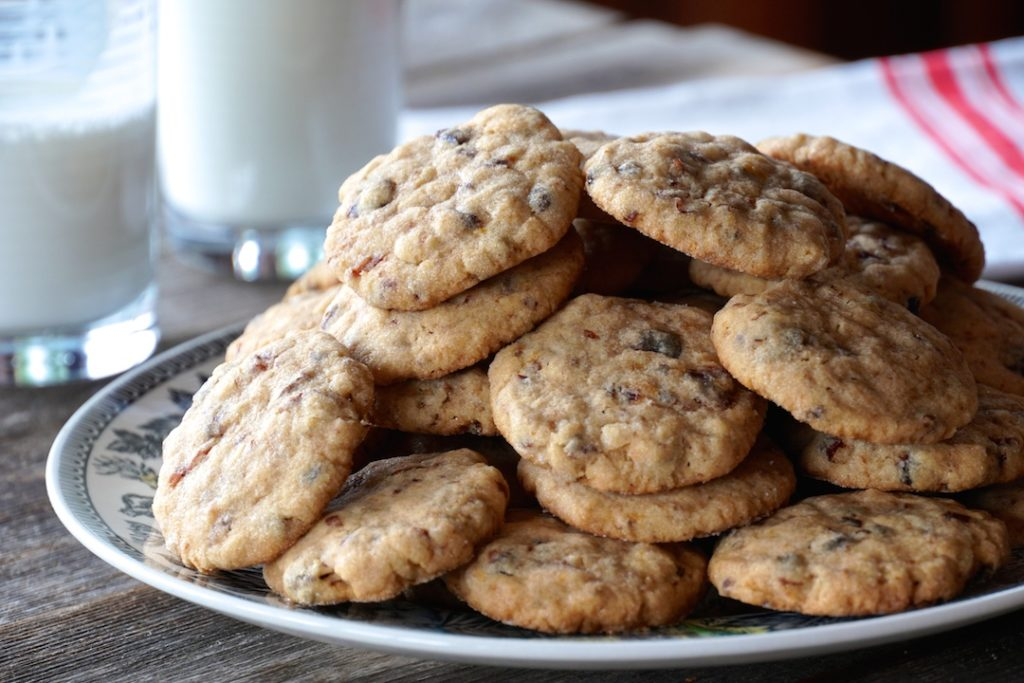 A plate of cookies, and a glass of milk