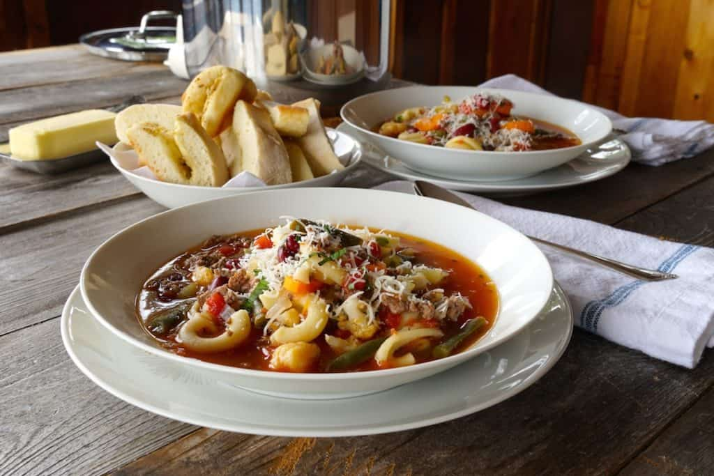 Bowls of minestrone soup with beef
