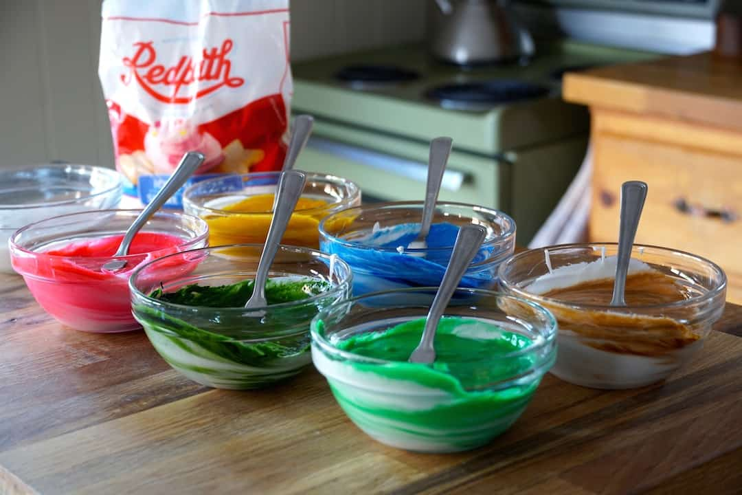 Assorted bowls of coloured royal icing