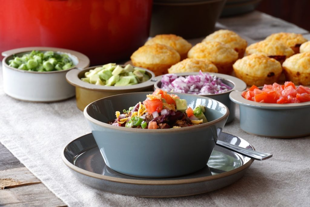 Best Beef Chili Recipe served with assorted garnishes