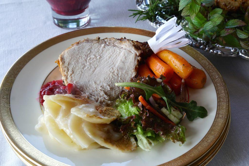Serving a plate of Crown Roast of Pork