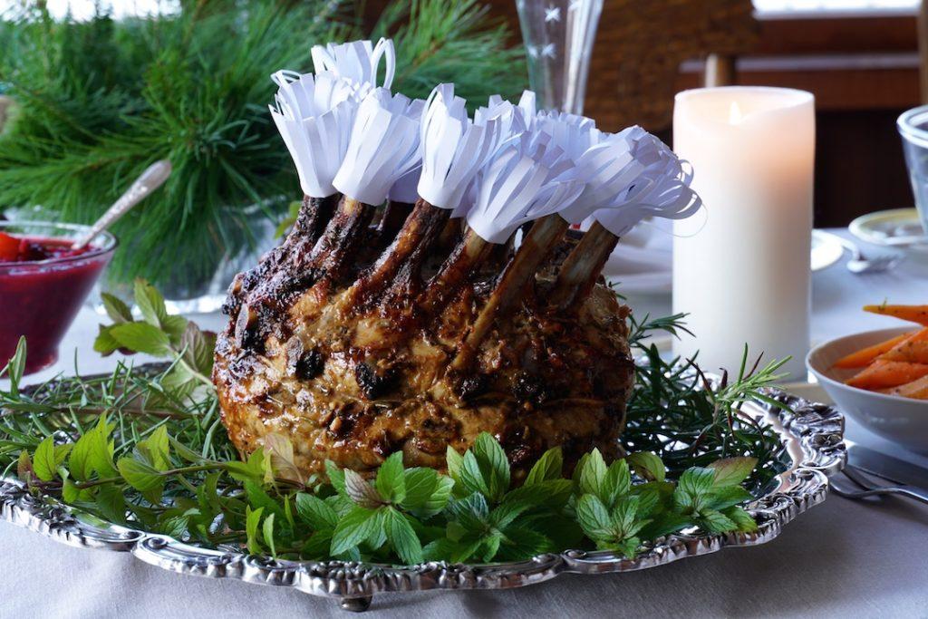 Crown Roast of Pork presented on a bed of fresh herbs