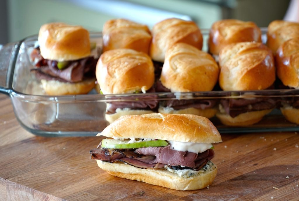 filling the baking dish with Roast Beef Hoagies
