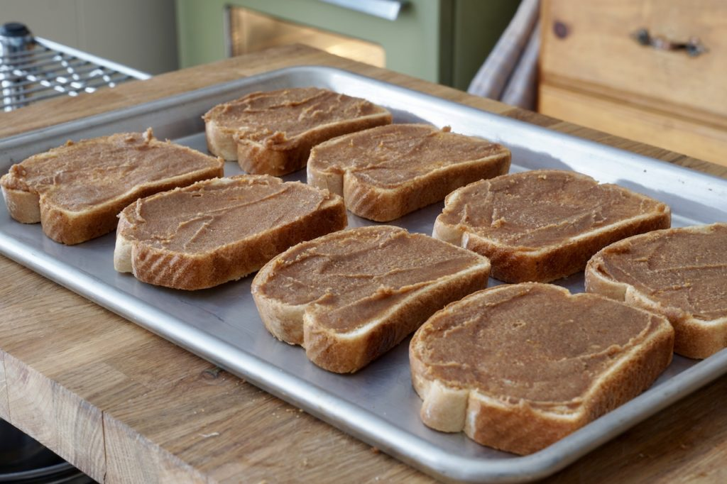 Slices of bread ready for the oven