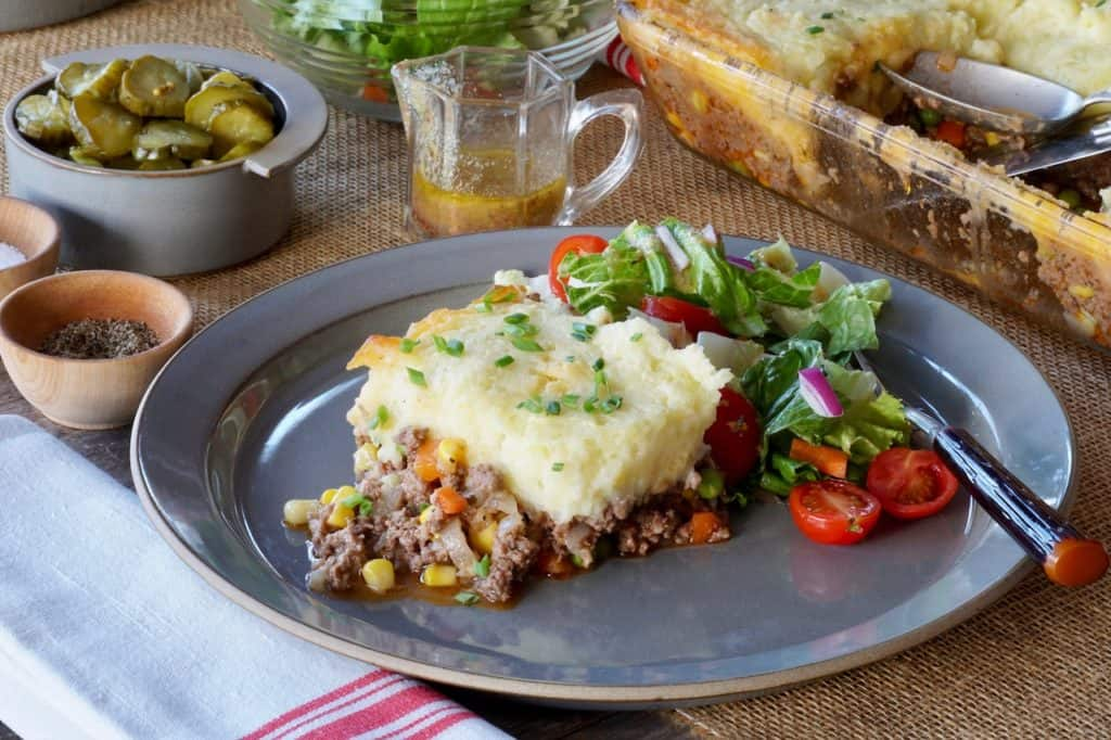 A plate of easy cottage pie served with green salad