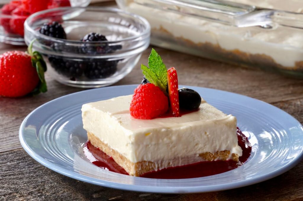 Cheesecake on a dollop of Mixed Berry Coulis