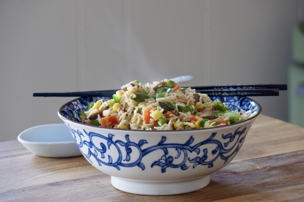a steaming bowl of Fun Fried Rice